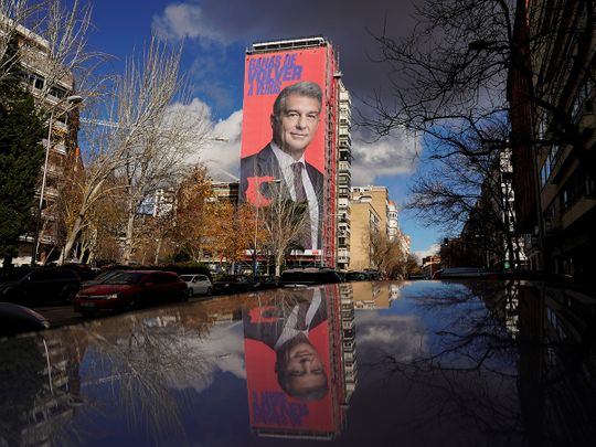 A giant electoral poster of Barcelona presidential hopeful Joan Laporta is seen on a building next to the Santiago Bernabeu Stadium in Madrid.