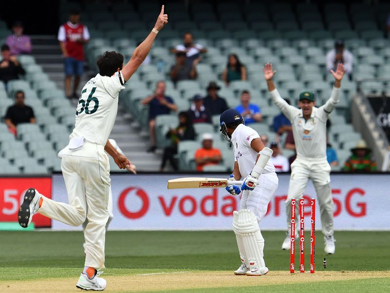 Australia's paceman Mitchell Starc celebrates his first wicket of India's batsman Prithvi Shaw on the first day of the cricket Test match between Australia and India in Adelaide.