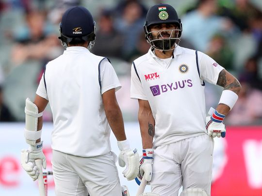 Virat Kohli and Ajinkya Rahane during the first Test against Australia in Adelaide