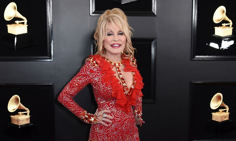 FILE - Dolly Parton arrives at the 61st annual Grammy Awards on Feb. 10, 2019, in Los Angeles. Parton is among the entertainers who took the initiative to make the best out of a challenging year. The country music icon donated $1 million toward researching the coronavirus at Vanderbilt University Medical Center in Nashville, Tenn. (Photo by Jordan Strauss/Invision/AP, File)