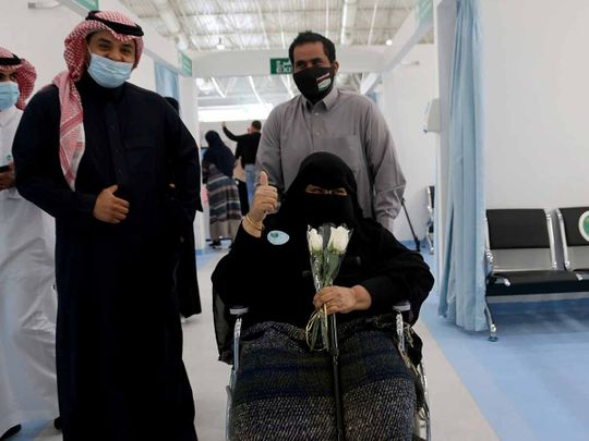 A Saudi woman gestures after she received the first dose of a coronavirus disease (COVID-19) vaccine, in Riyadh, Saudi Arabia December 17, 2020.