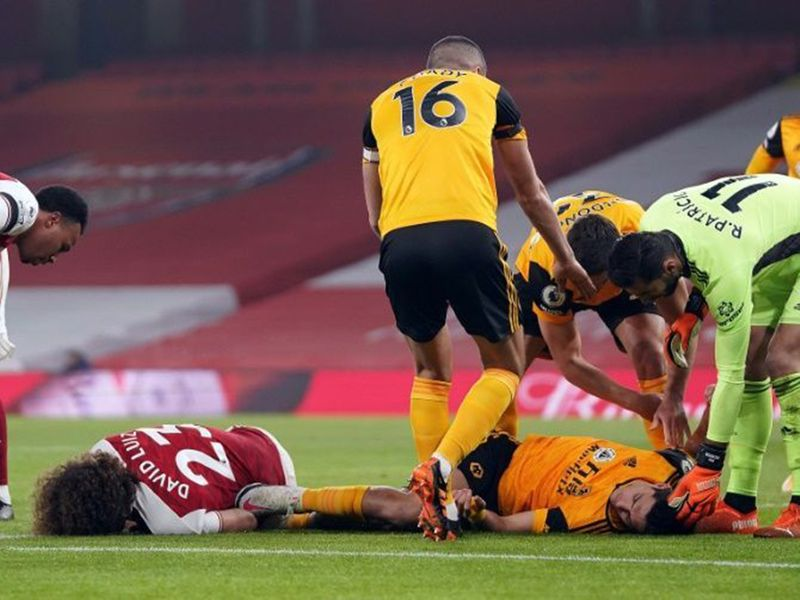 Arsenal's David Luiz was allowed to continue after a horror clash of heads with Wolves' Raul Jiminez