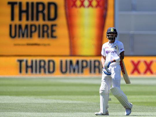 India's Virat Kohli waits as he walks off as the third umpire checks the catch that takes Kohli's wicket for 4 runs against Australia