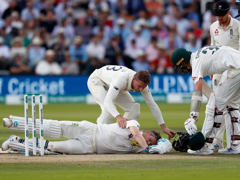 Steve Smith lies on the ground after being hit on the head by a Jofra Archer bouncer