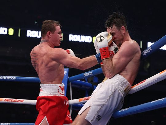 Canelo Alvarez thumps Callum Smith during their WBA, WBC and Ring Magazine super middleweight championship bout