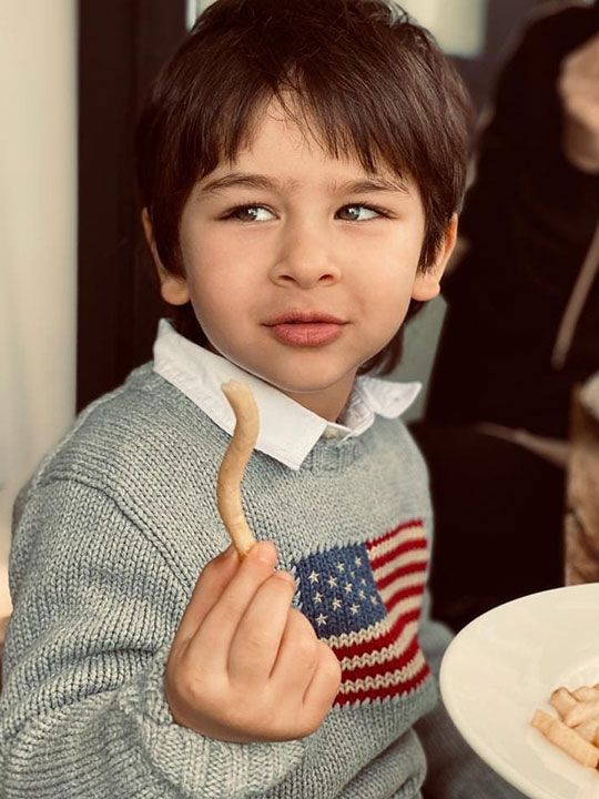Taimur eating french fry