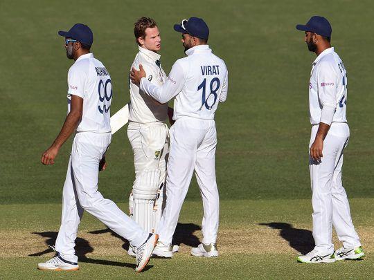 Australia's Steve Smith (2nd L) talks with India's Virat Kohli