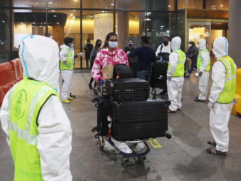 Passengers arrive Mumbai mask covid