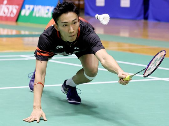 Japan's badminton world No. 1 Kento Momota competes in the first round of All-Japan National Championships in Tokyo on December 23,