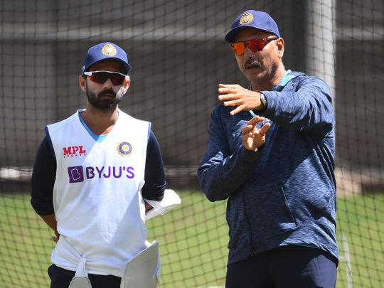 Ajinkya Rahane speaks to India head coach Ravi Shastri during training in Melbourne