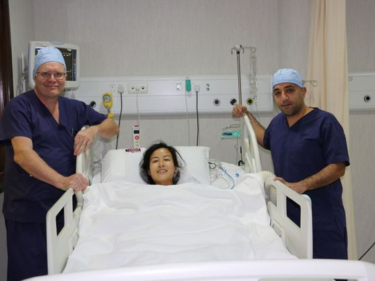 Carryll Chuang with Prof. Dr. Matthias Honl (left) after the surgery at Burjeel Hospital for Advanced Surgery Dubai-1608815890223