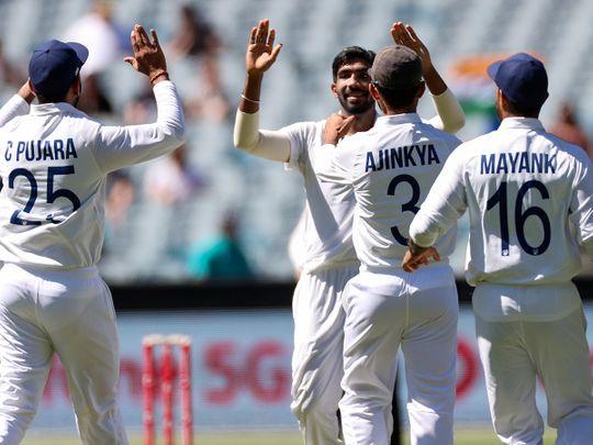 India's Jasprit Bumrah celebrates the wicket of Australia's Joe Burns
