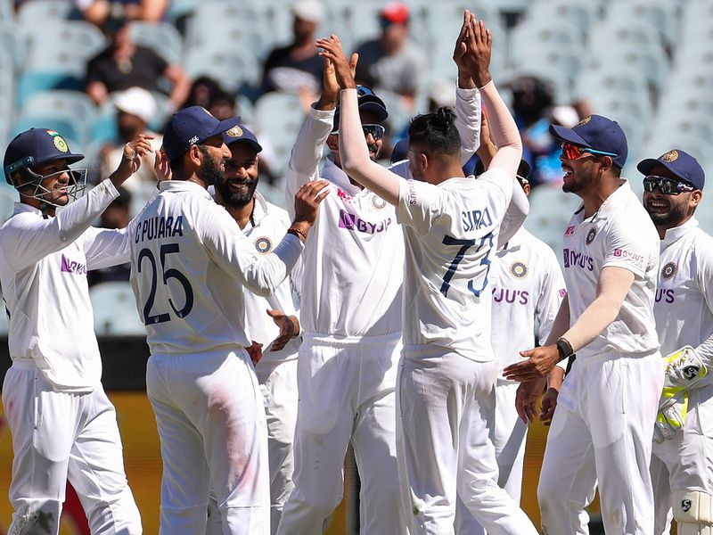 India's MD Siraj is congratulated by teammates after dismissing Australia's Cameron Green during play on day one of the Boxing Day cricket test between India and Australia at the Melbourne Cricket Ground, Melbourne, Australia, Saturday, Dec. 26, 2020. (