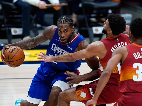 Kawhi Leonard overcame a bloodied face to help the LA Clippers defeat Denver Nuggets
