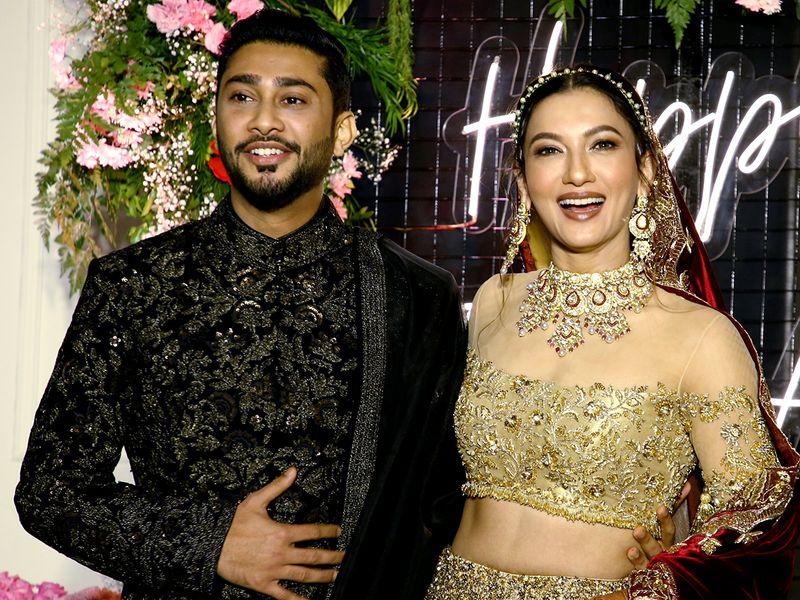 Mumbai: Bollywood actress Gauhar Khan along with her husband Zaid Darbar poses for photographs during their wedding reception, in Mumbai, Friday, Dec. 25, 2020. (PTI Photo)(PTI25-12-2020_000271B)