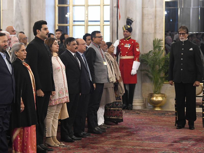 Amitabh Bachchan stands for the National Anthem along with Union Minister of Information and Broadcasting Prakash Javadekar, wife Jaya Bachchan (2nd L), son Abhishek Bachchan (3rd L) and other dignitaries before receiving Dadasaheb Phalke Award from President Ram Nath Kovind at Rashtrapati Bhavan in New Delhi.