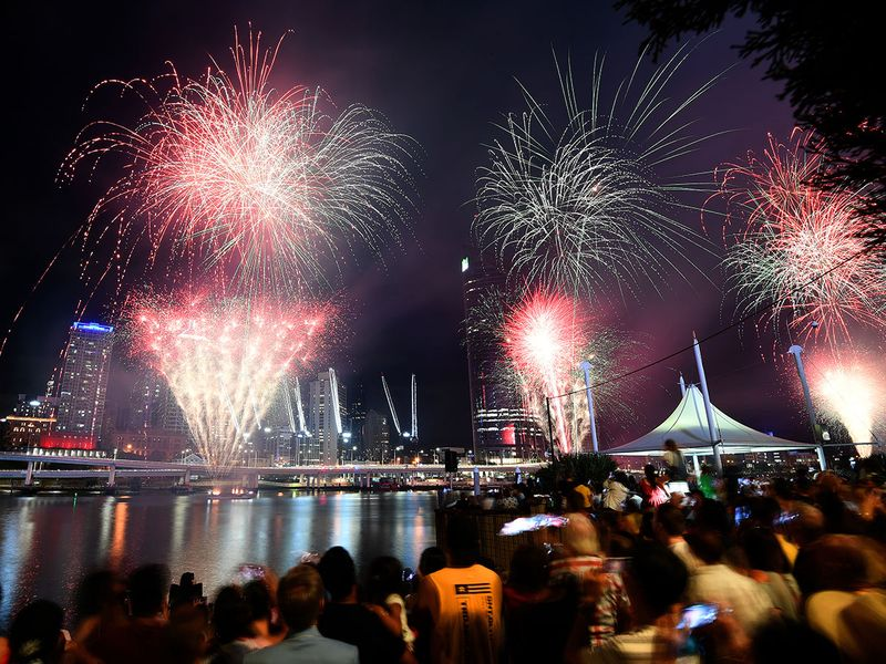 Crowds watch a fireworks display during New Year's Eve celebrations in Brisbane, Australia.