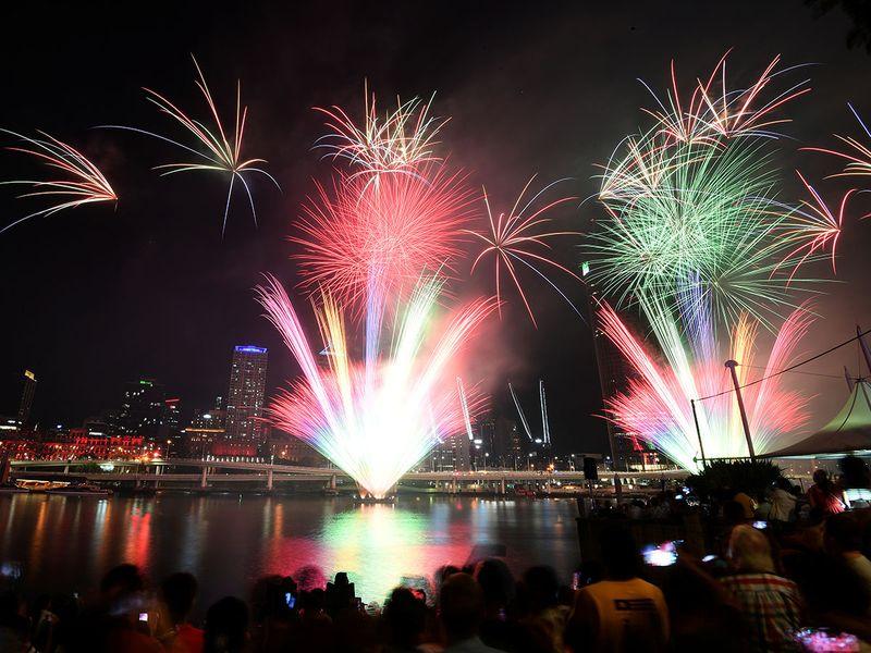 Crowds watch fireworks display during New Year's Eve celebrations in Brisbane, Australia.