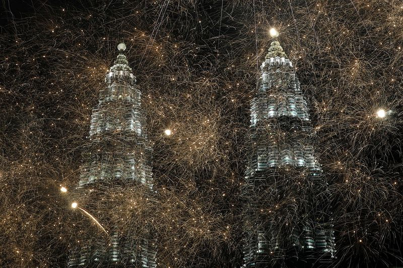 Fireworks explode near Petronas Twin Towers during New Year celebrations in Kuala Lumpur, Malaysia.