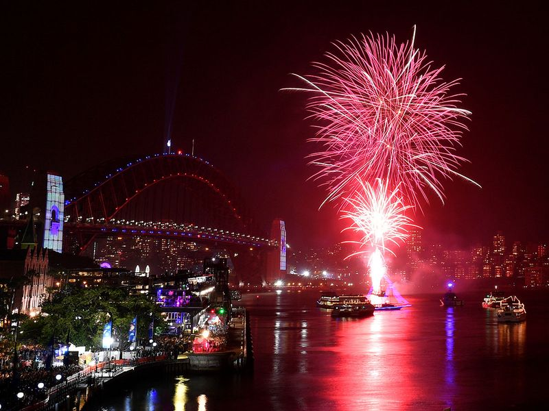 Fireworks explode over the Sydney Opera House and Sydney Harbour Bridge during New Year's Eve celebrations in Sydney.