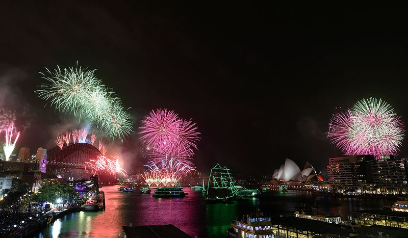 Fireworks explode to welcome in the New Year over the Sydney Harbour Bridge