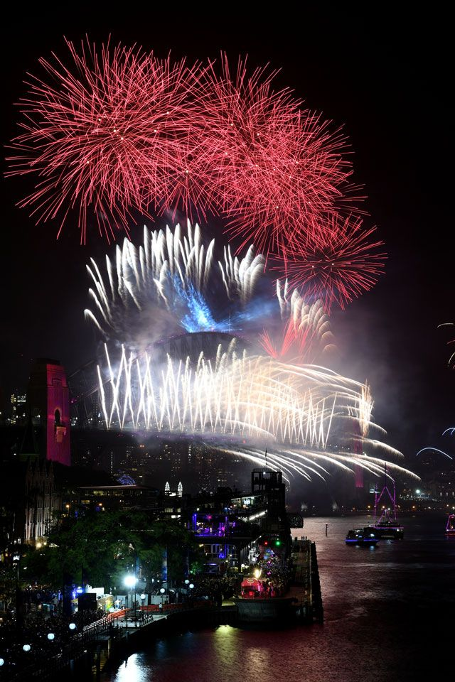 Fireworks explode to welcome in the New Year over the Sydney Harbour Bridge and the Sydney Opera House, as seen from Cahill Expressway during New Year's Eve celebrations in Sydney, Australia.