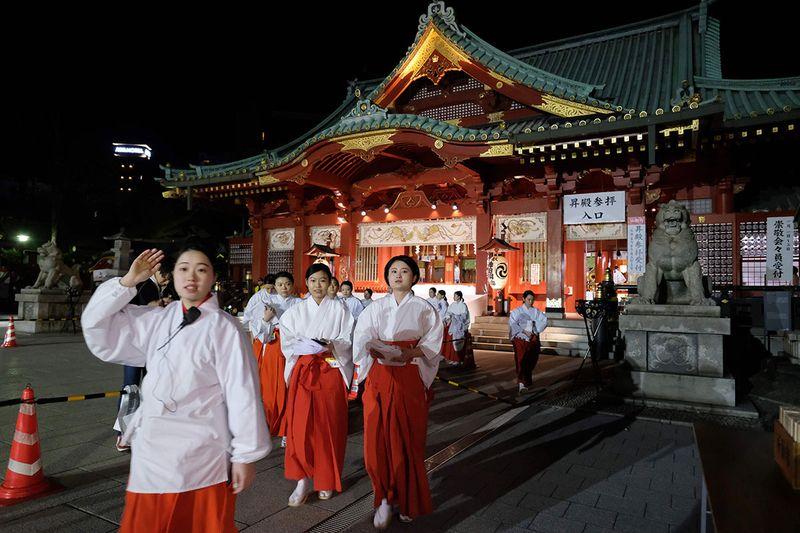 Japanese priestess prepare for New Year prayers at Kanda Myojin Shrine in Tokyo.
