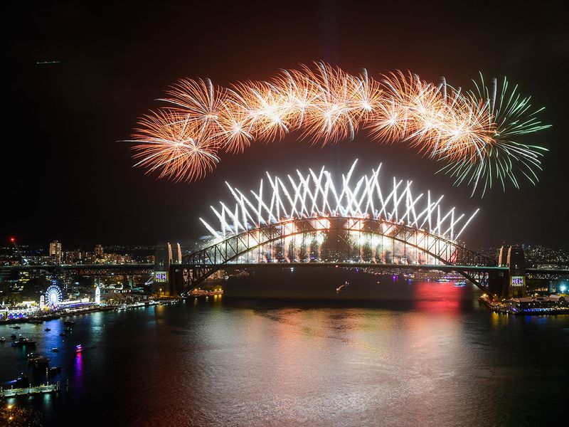 Midnight fireworks explode over the Sydney Harbour Bridge during New Year's eve celebrations in Sydney, Australia.