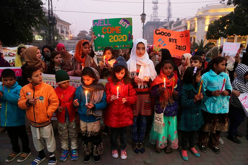Pakistani children light candle to welcome the New Year in Lahore