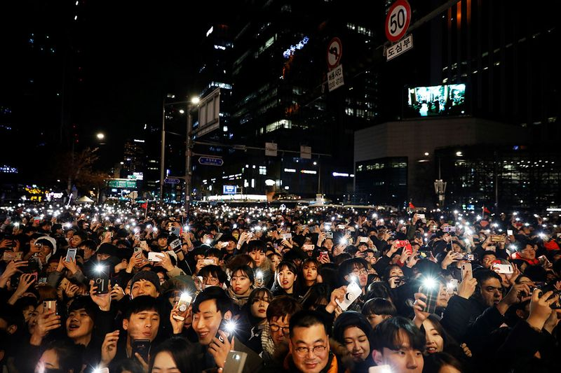 People attend a ceremony to celebrate the New Year in Seoul, South Korea.