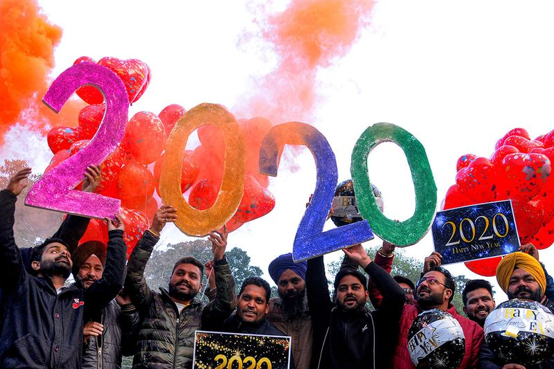 People pose for photographs as they welcome the New Year 2020, in Amritsar, India.