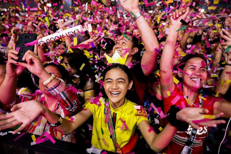Reveller celebrate as confetti falls