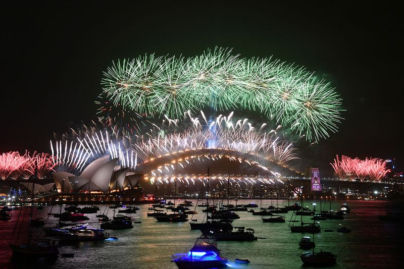 The midnight fireworks are seen from Mrs Macquarie's Chair during New Year's Eve celebrations in Sydney, Australia.