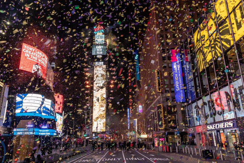 Confetti flies around the ball and countdown clock in Times Square during the virtual New Year's Eve event following the outbreak of the coronavirus disease (COVID-19) in the Manhattan borough of New York City, New York, U.S., January 1, 2021. REUTERS/Jeenah Moon REFILE - CORRECTING DATE