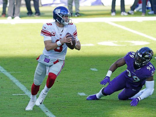 New York Giants quarterback Daniel Jones pressured in the second quarter by Baltimore Ravens linebacker Matthew Judon
