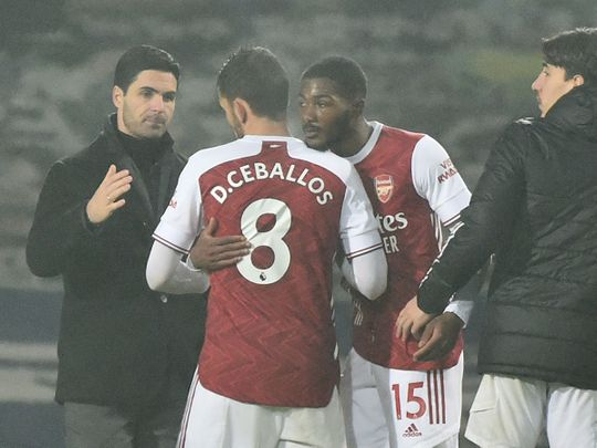 Arteta congratulates his Arsenal players following the win over West Brom.