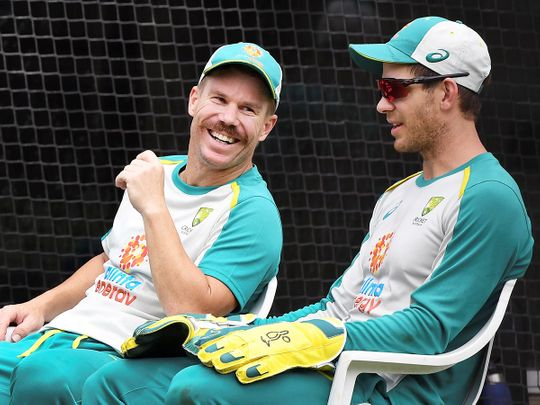 David Warner (L) chats with captain Tim Paine (R)