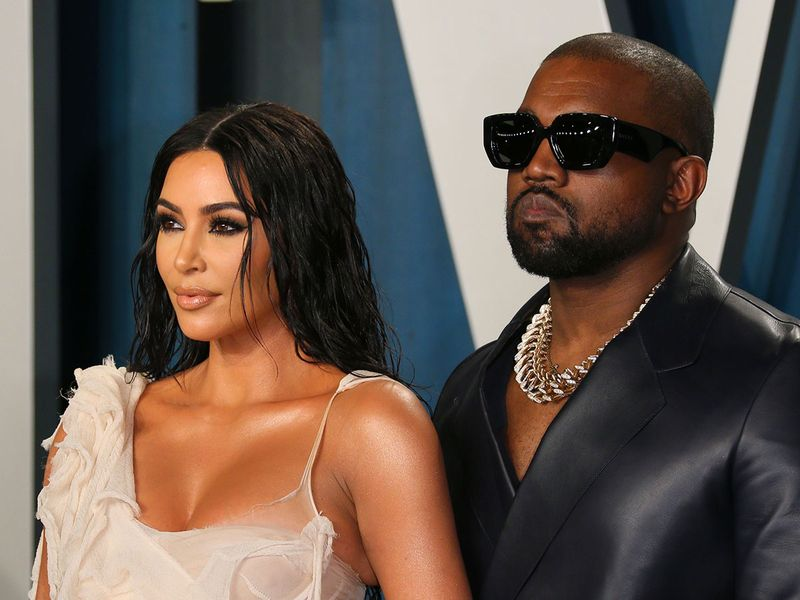 Kim Kardashian (L) and husband US rapper Kanye West