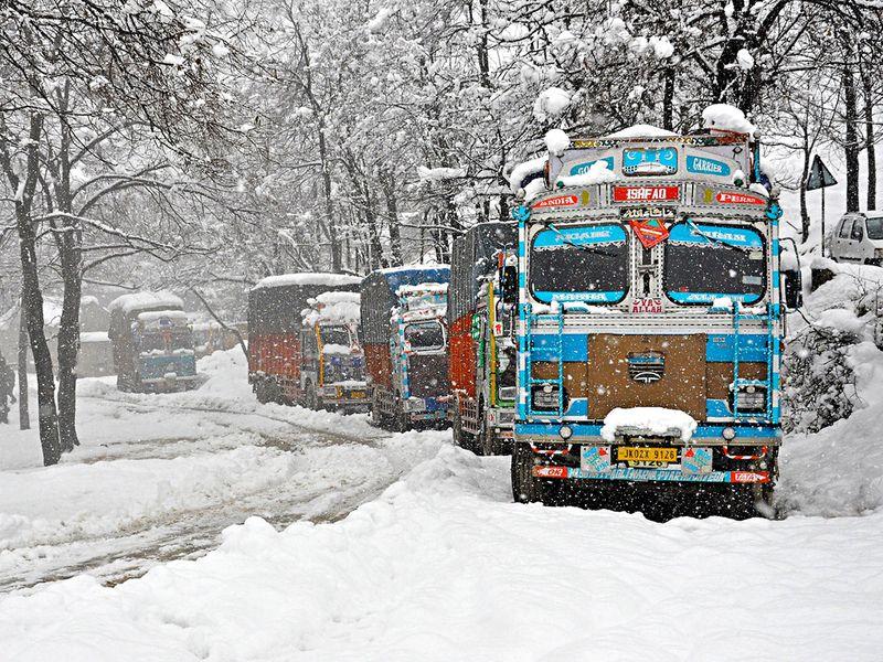 Trucks stranded at Srinagar-Jammu National highway during heavy snowfall, in Qazigund.