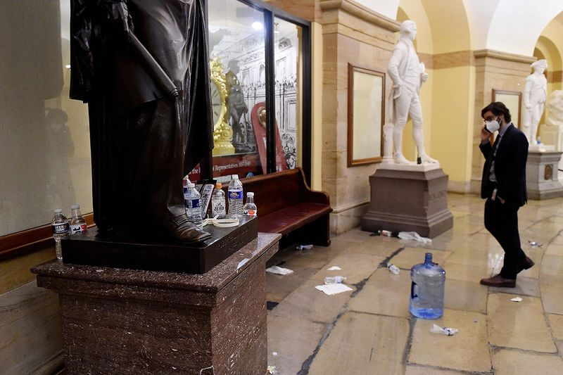 Damage is seen inside the US Capitol building early on January 7, 2020 in Washington, DC, after supporters of US President Donald Trump breeched security and entered the building during a session of Congress.