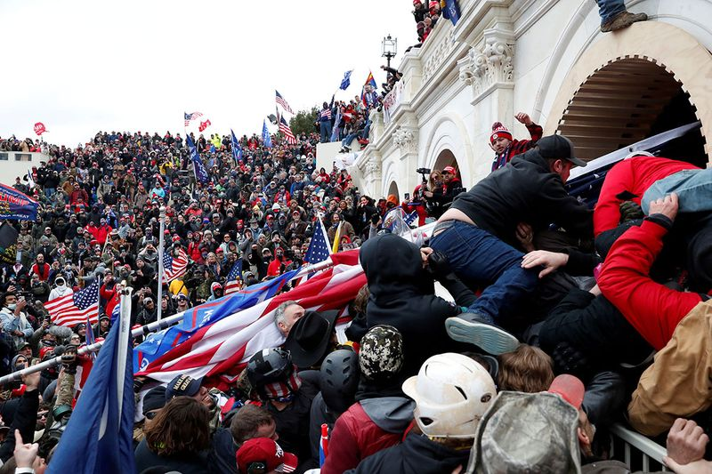 Pro-Trump protesters storm into the U.S. Capitol during clashes with police, during a rally to contest the certification of the 2020 U.S. presidential election results by the U.S. Congress, in Washington, U.S, January 6.