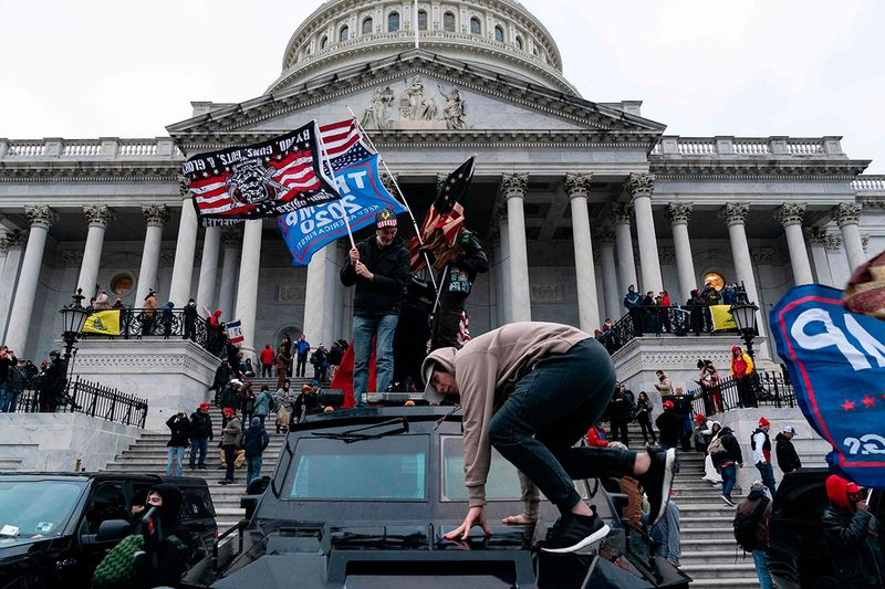 Supporters of US President Donald Trump protest outside the US Capitol.