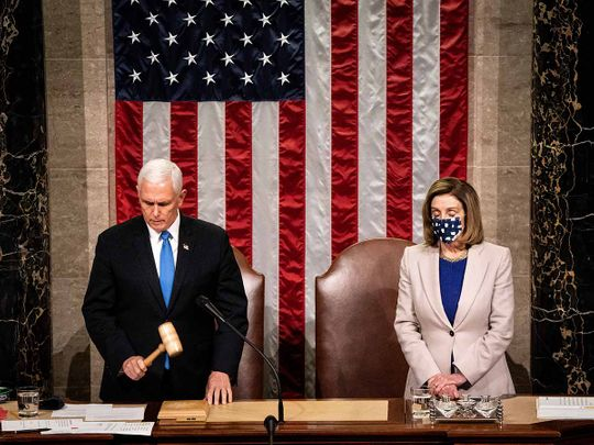 U.S. Vice President Mike Pence and U.S. House Speaker Nancy Pelosi, a Democrat from California, preside over a joint session of Congress to count the Electoral College votes of the 2020 presidential election in the House Chamber in Washington, D.C., U.S., on Wednesday, Jan. 6, 2021