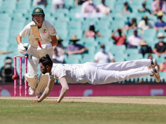 Australia's Marnus Labuschagne plays the ball past Indian bowler Mohammed Siraj during play on day four of the third cricket test between India and Australia at Sydney Cricket Ground