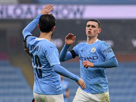 Phil Foden makes it three for Manchester City against Birmingham