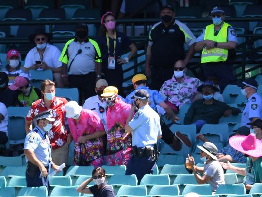 Police remove a group of spectators from their seats after Mohammed Siraj of India complained to umpires of being racially abused during day four of the third test match between Australia and India at the SCG in Sydney