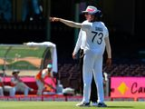 India's Mohammed Siraj gestures next to the umpire as the game was halted after allegedly some remarks were made by the spectators on the fourth day of the third cricket Test match between Australia and India at Sydney Cricket Ground.