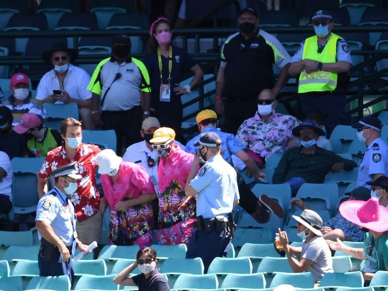 Police remove a group of spectators from their seats after Mohammed Siraj of India complained to umpires of being racially abused during day four of the third Test match against Australia.