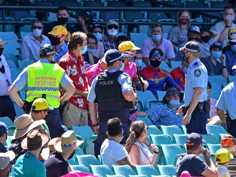 Police speak to spectators during the Australia v India third Test.
