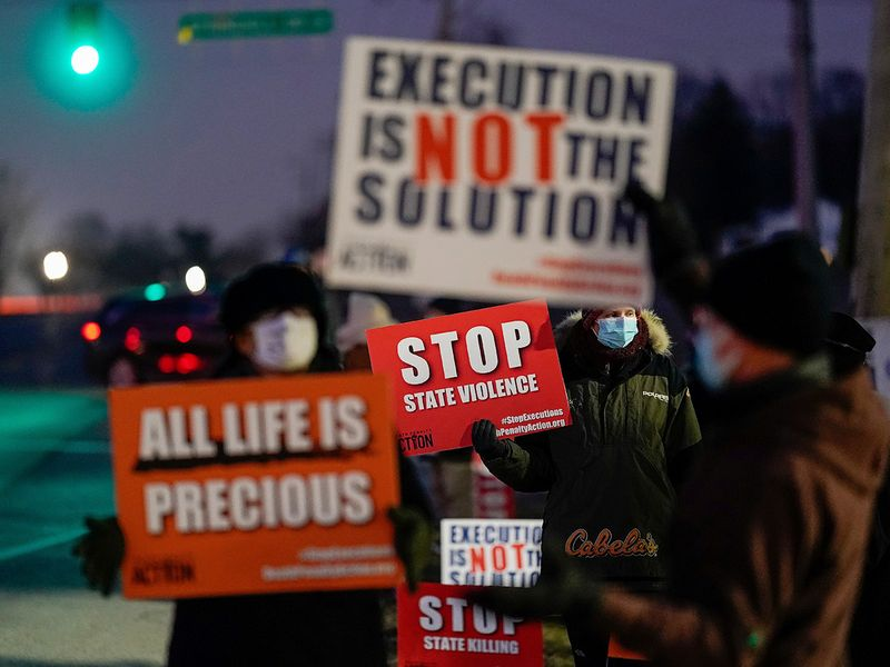 Activists in opposition to the death penalty gather to protest